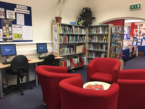 Alston Local Links interior showing seating area, computers and library
