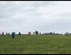 Children running around Long Meg stone circle
