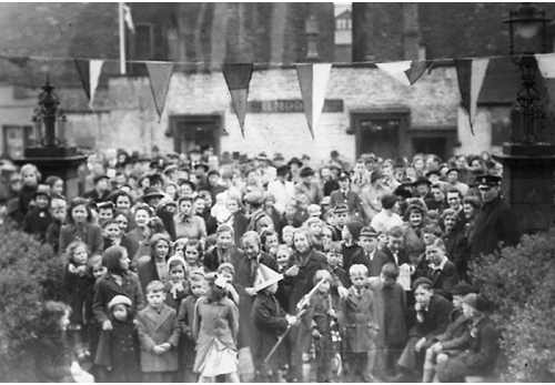 Reverent Tom Cross's VE Day image of a portion of the crowd outside Penrith Town Hall